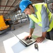 Stock Photo: Engineer using laptop computer on construction site
