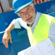 Stock Photo: Architect standing on construction site