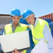 Engineers meeting on building site — Stock Photo