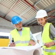 Stock Photo: Construction workers meeting on building site