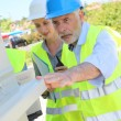 Stock Photo: Construction workers checking building structure