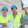 Workteam on building site — Stock Photo