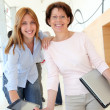 Portrait of smiling women in business training — Stock Photo