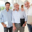Portrait of smiling men in business training — Stock Photo #18217589