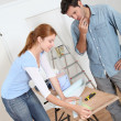 Couple choosing wallpaper color for new house  — Stock Photo
