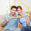 Young couple buying new home — Stock Photo #18218353