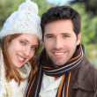 Portrait of attractive couple in winter — Stock Photo