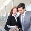 Business team meeting outside the airport — Stock Photo #18218769
