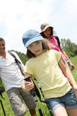 Family rambling in country field — Stock Photo
