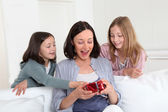 Girls giving present on mom birthday — Stock Photo