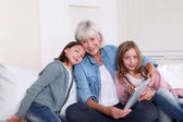 Senior woman with grandkids playing with touchpad — Stock Photo