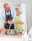 Senior couple preparing apricot jam — Stock Photo