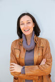 Portrait of smiling woman with turtleneck sweater — Stock Photo