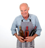 Portrait of senior winemaker holding bottles of wine — Stock Photo