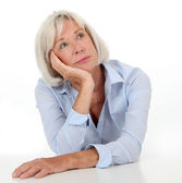 Portrait of senior woman with bored expression — Stock Photo