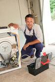 Plumber fixing washing machine — Stock Photo