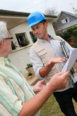 Architect meeting private individual at home — Stock Photo