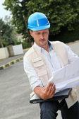 Entrepreneur looking at construction map — Stock Photo