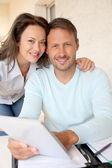 Couple using electronic tablet at home — Stock Photo