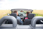 Couple riding convertible car — Stock Photo