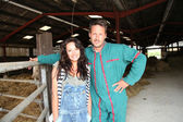 Couple of breeders standing in barn — Stock Photo