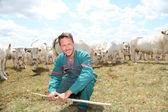 Portrait of breeder standing in farmland — Stock Photo