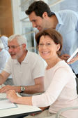 Portrait of senior woman attending computing training — Stock Photo