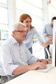 Senior man attending business training — Stock Photo