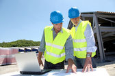 Industrial working on building site — Stock Photo