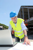 Engineer with security helmet on construction site — Stock Photo