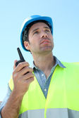 Foreman using walkie-talkie on construction site — Stock Photo