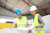 Construction workers meeting on building site — Stock Photo