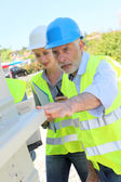 Construction workers checking building structure — Stock Photo