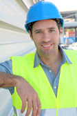 Portrait of young worker with security helmet — Stockfoto