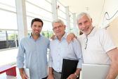 Portrait of smiling men in business training — Stock Photo