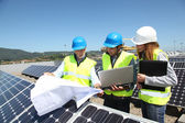 Group of engineers meeting on building roof — Stock Photo