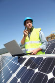 Engineer checking photovoltaic installation — Stock Photo