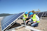 Engineers checking solar panels running — Stock Photo
