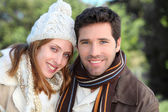 Portrait of attractive couple in winter — Stok fotoğraf