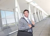 Businessman standing with briefcase — Stock Photo