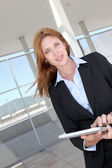 Businesswoman using electronic tablet outside — Stock Photo