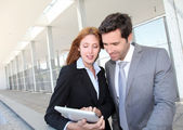 Business team meeting outside the airport — Stock Photo