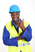 Construction worker showing thumb up — Stock Photo