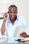 Salesman in office talking on the phone — Stockfoto