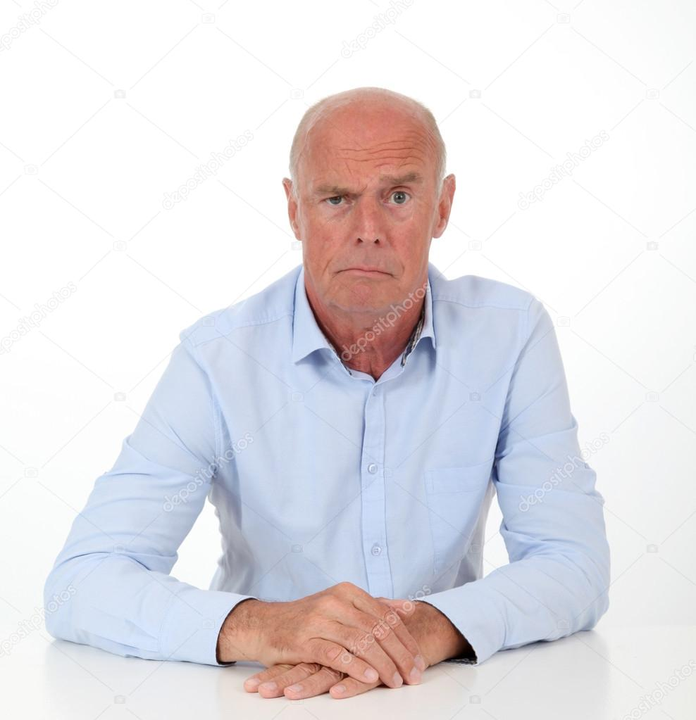 Senior man with interrogative look  Stock Photo #18212571