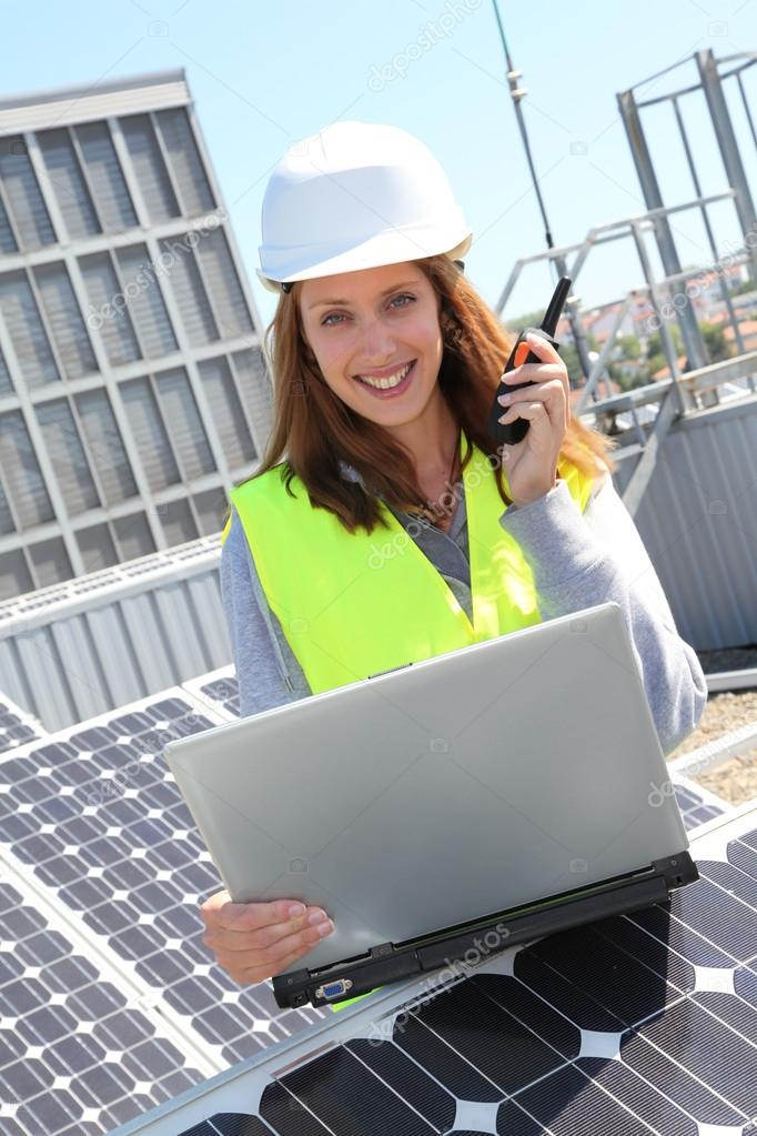 Woman engineer on solar panels site — Stock Photo #18216731