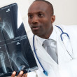 Stock Photo: Doctor checking X-Ray