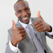 Portrait of businessman showing thumbs up — Stock Photo