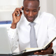 Businessman talking on the phone in office — Stock Photo #18221277