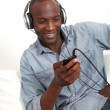 Cheerful man listening to music — Stock Photo #18221355